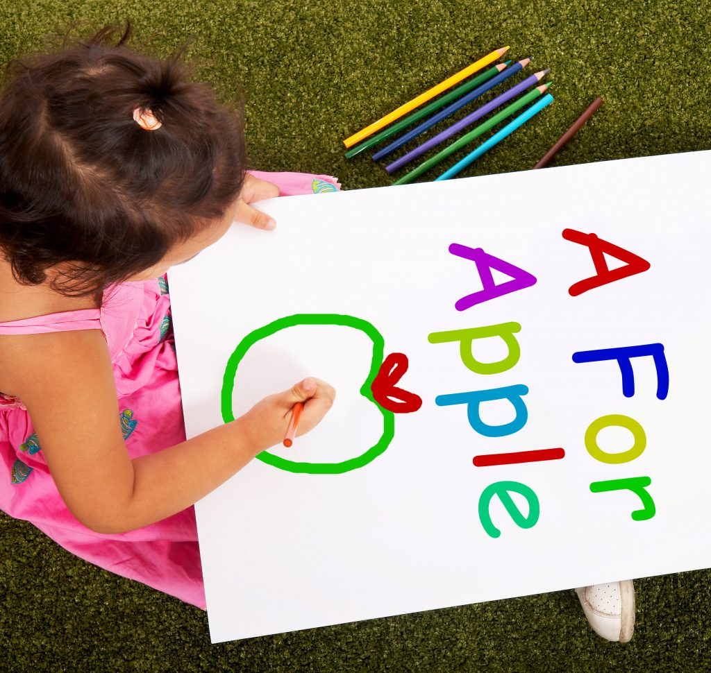 Girl Writing Apple Shows Kid Learning The Alphabet