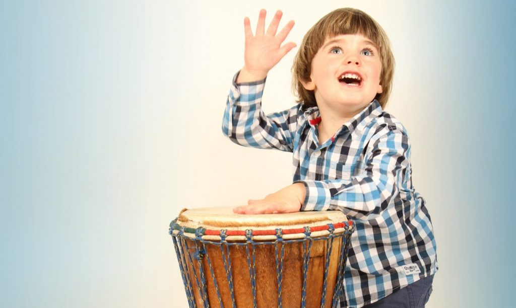 toddler with drum